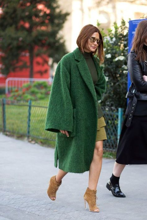 Christine Centenera wearing oversize green coat at Paris Fashion week