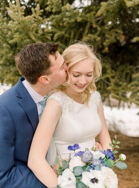 The details included in the outfits of this bride and groom are stunning! The colors just work so well together. These winter bridal photos turned out so pretty! All the blue hues paired perfectly with the trees and snow. I love being able to capture moments like this all year round in such beautiful places! #utahweddingphotography #weddingportraits #bridals #weddingdress #brideandgroompictures #winterwedding #weddingphotography