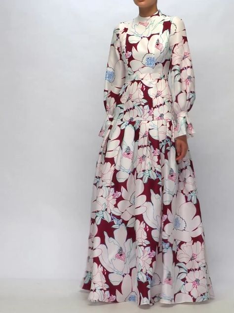 The magnified floral pattern illustrating Carolina Herrera's white and burgundy Orleander gown heightens the impact of the striking couture-inspired silhouette. It's crafted in the USA from heavyweight silk-gazar, and features a slender waist which is balanced by the feminine balloon sleeves and floor-sweeping pleated hem panel. Wear your hair in a neat chignon and slip on stiletto sandals for a confident appearance at a gala dinner.