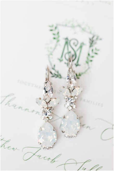 Elegant moonstone and diamond drop bridal earrings. Silver wedding jewelry with moonstones and diamonds. Perfect earrings for an elegant bride. Brittany Pannebaker Photography. #weddingaccessories #moonstone #bridaljewelry #dropearrings #tampawedding