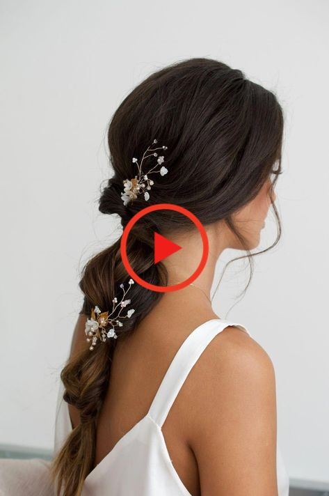 Boho wedding styling long brown hair in loose braid with baby's breath and foliage in hair #weddingbraids #longhairstyles #shorthairstyles