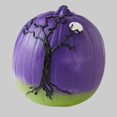 Use paint and caulk to create an eerie landscape for a twist on the traditional pumpkin.