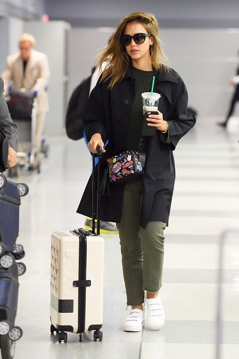Etro sunglasses; The Great Slouch Army Pants ($171); Anya Hindmarch All Over Wink Crossbody Bag ($1295); Loms Carry-On Spinner ($695); Sandro sneakers.