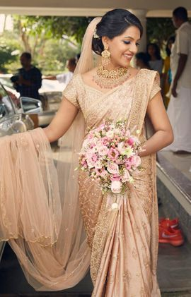 Its Golden Color Probably Acceptable In Catholic Weddings Christian Wedding Sarees Christian Bridal Saree Saree Wedding