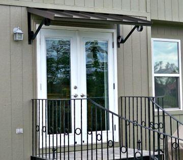 The Classic Metal Awning In Bronze Over Double Doors In Edenton Nc Door Awnings Double Doors Exterior Portico Design