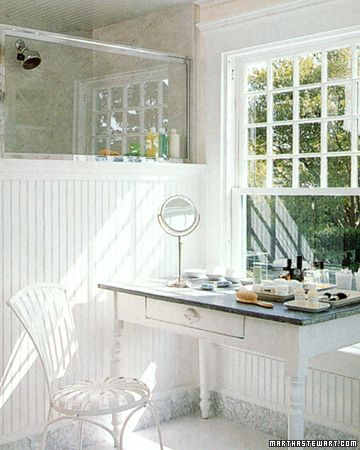 Windowsill Vanity: Natural lighting is key when applying makeup, so set your table up next to a large window. This sweet, summertime vanity, featured in Martha Stewart uses a button patio chair, vintage vanity table, and assorted beige trays to hold makeup and toiletries.