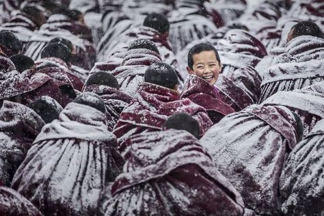 13 Photos That Will Inspire You To Get Off The Couch And See The World| A smiling young Lama at Labrang Monastery, Tibet.