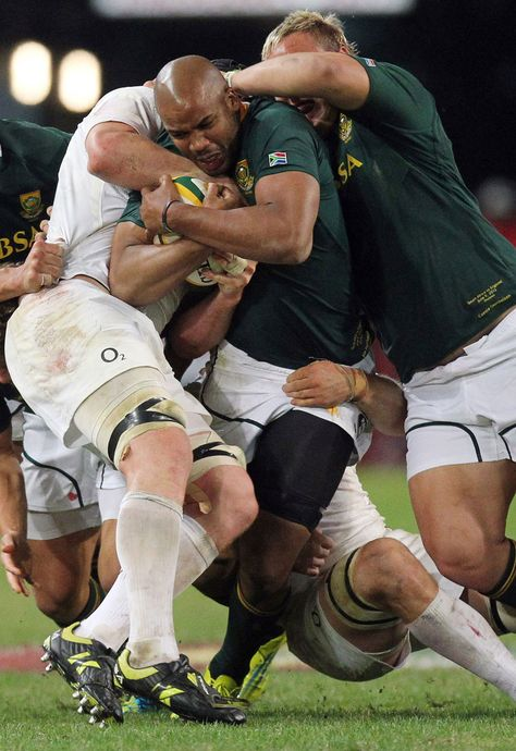 South Africa's JP Pietersen is tackled by England's Ben Morgan