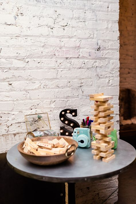 Game table with Jenga and instax camera at The Joinery Chicago wedding
