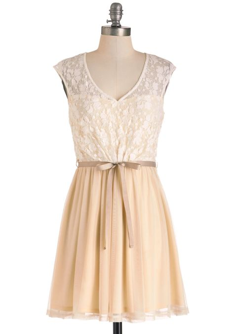 White Haute Cocoa Dress. Youre known for putting unique spins on classics, which is why you pair this luxe vanilla lace dress with your brightest brights for a winter look that amazes at your dinner party. #cream #wedding #bridesmaid #modcloth