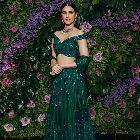 Kriti Sanon at Dinesh Vijan's Wedding Reception : Kriti looked lovely in a bright green embellished Zara Umrigar lehenga with simple makeup and a sleek mid-parted hairdo.