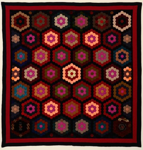 """Mennonite Hexagons Quilt: Circa 1870; Pennsylvania.  Almost entirely made of fine wools with a few scattered pieces of velvet. The back is a chestnut colored wool. It is in excellent condition; measurements are 76"""" x 79""""."""