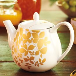 Celebrate the holidays with the Winter Garden Teapot Set, a festive, procelain set decorated in gold leaves. Includes 2 cups and oversized saucers. $49.95 at teavana.com.