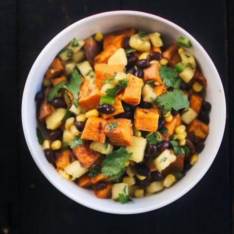 Vegetarian roasted sweet potato salad with black beans & a fresh sweet pineapple corn salsa. Perfect for potlucks & parties. #vegetarian #lunchidea #saladrecipe #sweetpotatoes #blackbeans #potluck #partyfood