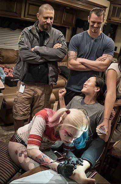 Margot Robbie tattooed her coworkers with SKWAD while fully dressed as Harley Quinn lol