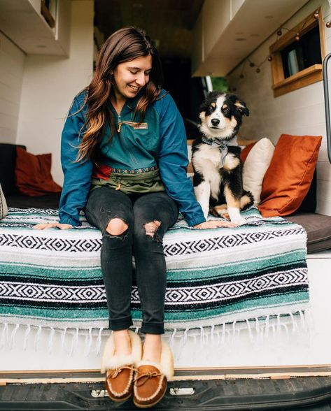 Coziness is soft slippers, a warm blanket and a happy dog. (📷: Instagram's @photocait)  Click the image to shop slippers and anorak from L.L.Bean.