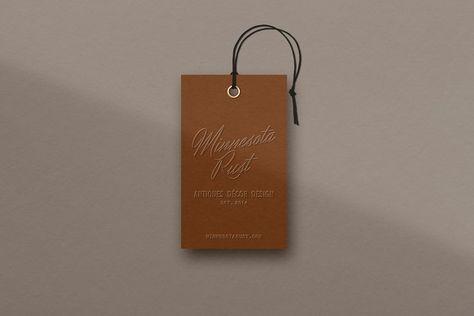 tag design, shopping and retail, logo design, holistic design, burnt orange, typography, typography system, color scheme, color palette, web design, branding for retail shop, blind embossed hang tags, rebrand, brand's signature hue