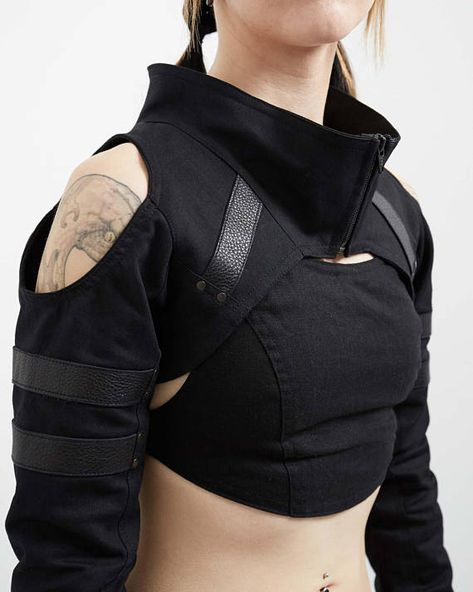 The Variant is our newest shrug, and designed to be as aggressively comfortable as it is stylish. Made with black stretch denim and accented with leather strapping, it features open shoulders and double cuffs for ease of movement and proper fit across all body sizes. For a