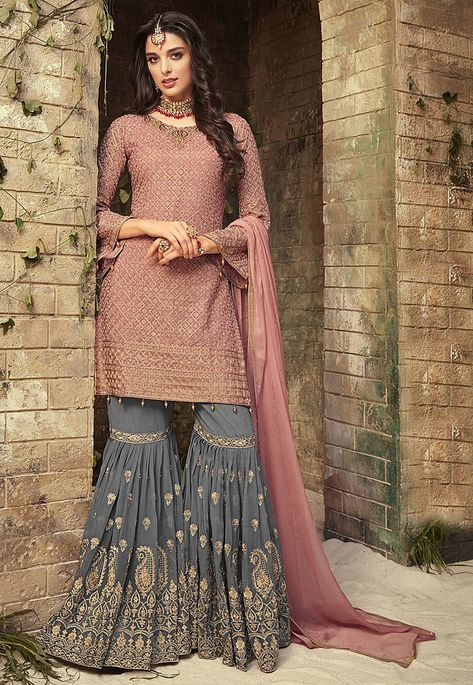 Charming pink embroidered sharara suit online which is crafted from georgette fabric with exclusive embroidery and hand work. This stunning designer sharara suit comes with georgette bottom and chiffon dupatta.