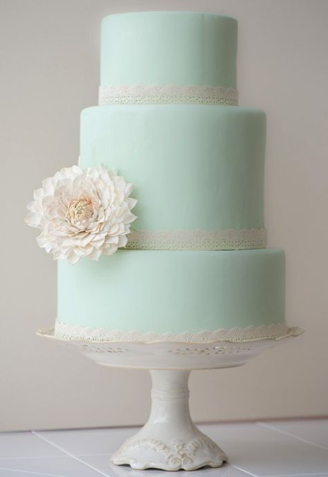 pretty simple cake: only change color from mint to white witha a colored flower to match theme :)
