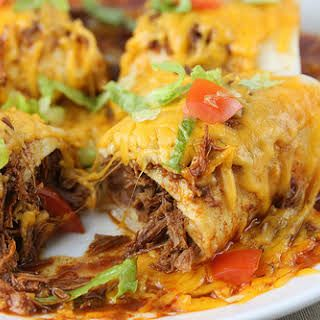 Smothered Burritos With Stew Meat Red Enchilada Sauce Beef Bouillon Cubes Refried Beans Flour Tortil Mexican Food Recipes Burritos Recipe Stew Meat Recipes