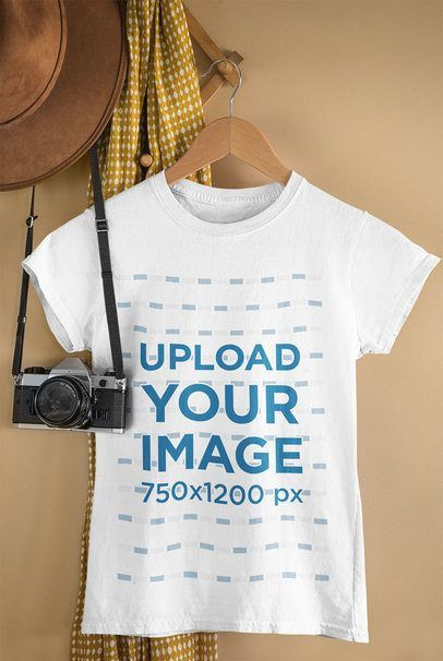 Download Placeit Mockup Of A T Shirt Hanging By A Vintage Camera In 2021 Shirt Mockup Clothing Mockup Tshirt Mockup