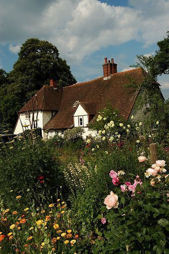 Manor Farm in Hampshire. I can't decide if I like the flowers, the perfect puffy clouds in the blue sky, or the lovely thatched roof more! English Country Cottages, English Countryside, Country Houses, Cute Cottage, Cottage Style, Garden Cottage, Cottage Homes, Cottage Bedrooms, Farm Cottage