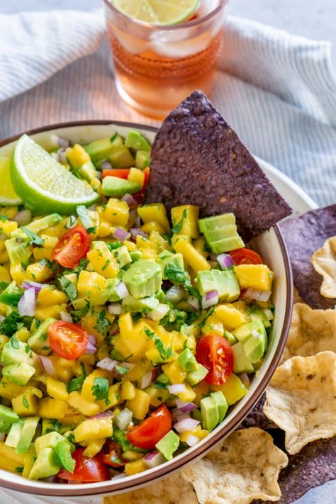 Avocado Mango Salsa is colorful and packed with flavor. Grab your chips and party dishes, this dish is a winner! #mangosalsa #salsarecipes
