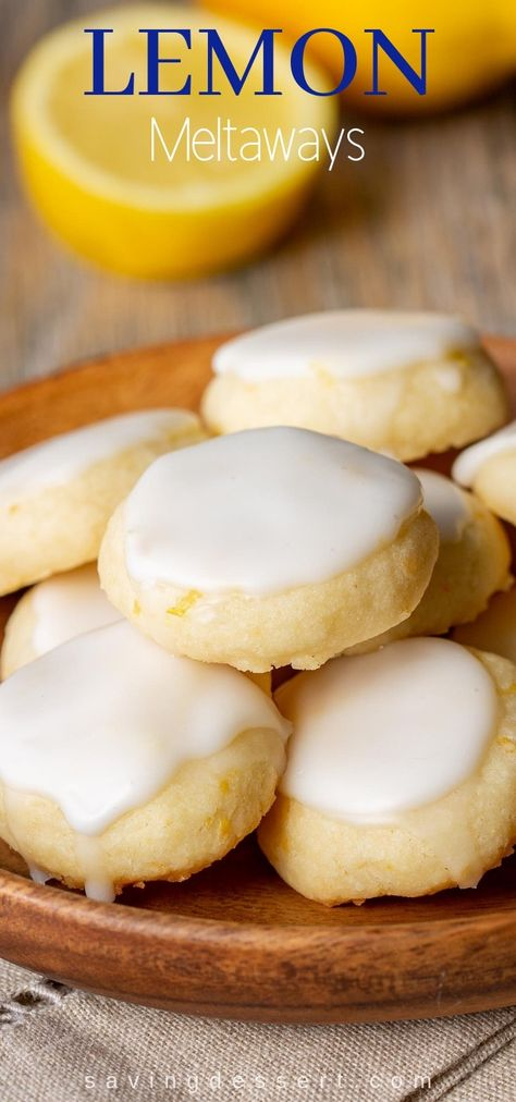 Lemon Meltaways ~ Light and buttery, these lemon bite-sized cookies are a real treat! Easy to make and the perfect little bite of lemon! #meltaway #meltawaycookies #cookies #lemoncookie #meltaways #lemonmeltaways #baking