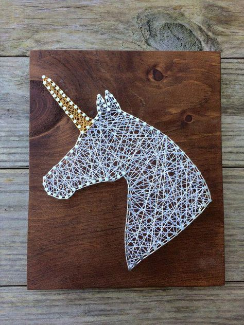 """Handmade string and nail art sign stained English Chestnut with a unicorn image in white and metallic gold string. Sign size is approximately 9x10"""". *For a different string or stain color, please request a custom order. #surrealist"""