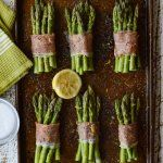 Prosciutto Wrapped Roasted Asparagus Bundles - Elegant enough to complement any dinner party, but simple and easy. Prosciutto is what brings it all together. #asparagus #asparagusbundles #prosciutto #sidedish #easyrecipe #veggies #vegetables #baconwrappedasparagus #makeaheadrecipe