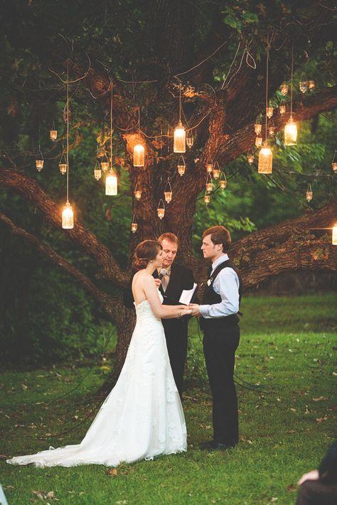 Romantic Mason jar lighting illuminates this rustic wedding