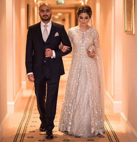 Another image of our stunning client Natasha Petafi of looking radiant in a Mina Hasan bridal at her wedding in London!