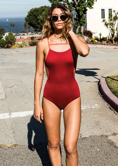 The RVCA Frothy Ribbed One-Piece is a ribbed one-piece swimsuit with an open back and side cutouts. It has a medium bottom coverage, an interior shelf b.