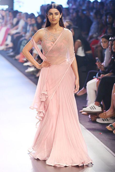 Buy Powder pink chiffon pre-draped saree & corset blouse by Anushree Reddy at Aza Fashions Buy Powder pink chiffon pre-draped sari & corset blouse by Anushree Reddy at Aza Fashions