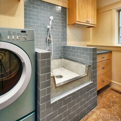 A shower pan on a raised platform beside the washer is designed for dog grooming, but also works great for spot-cleaning large items, like throw rugs.