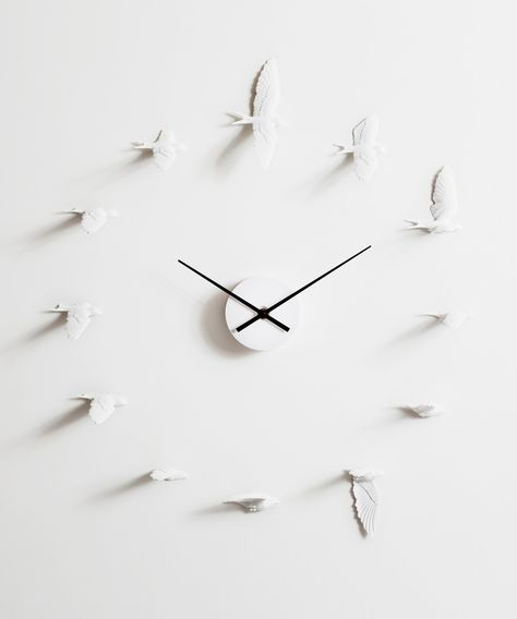 You watch swallows in flight and wonder at the lightness and ease of their kid-like dives. Freeze them just right to capture an absolutely memorable moment. Those moments make up your day with this stunning wall clock from Haoshi Design.