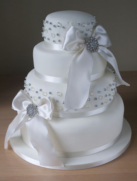 Wedding Cake wih silver beading, ribbon and bow detail...very pretty!     ᘡղbᘠ