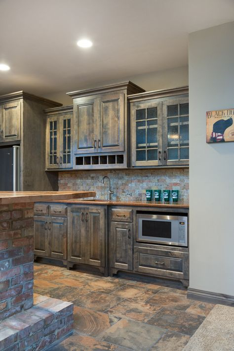 Shades Of Brown Pattern Tile Wet Bar Flooring With A Natural Stone Backsplash