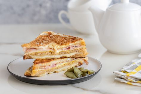 These classic Monte Cristo sandwiches are made with ham. cheese, and turkey or chicken. The sandwiches are dipped in egg and fried like French toast.