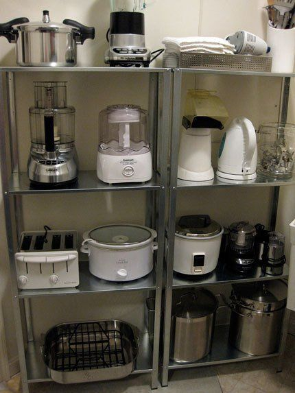 """I so """"NEED"""" these shelves in my kitchen for all my small appliances.Organize small appliances on open shelving units - would be great to put in the pantry to reduce the look of clutter around the kitchen. Steel shelves are from Ikea. Ikea Kitchen Shelves, Ikea Shelves, Kitchen Pantry, Kitchen Appliances, Small Appliances, Kitchen Cabinets, Storage Shelves, Kitchen Small, Kitchen Gadgets"""