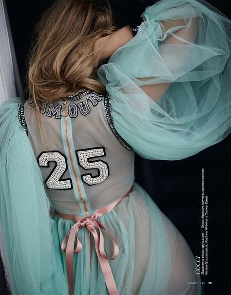 Dutch TopModel Marloes Horst goes candy for Elle Russia. The model wears a whimsical dress from Gucci with varsity style numbers