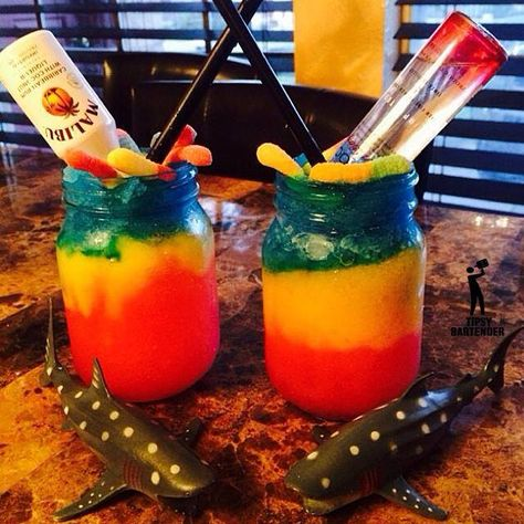 DANIELA'S SHARK ATTACK (-Red Layer-) Voda, Grenadine, Ice, Blend (-Yellow Layer-) , Orange Vodka, Mango Syrup, Ice, Blend, (-Blue Layer-) Blue Curacao, Coconut Rum, Ice, Blend ~ Add gummy worms and mini bottles of Malibu and Ciroc.