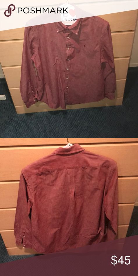 Men's long sleeve casual button down This redish/burgundy Ralph Lauren polo casual button down molds to your body perfectly without having that feeling that your arms are suffocating. Just a solid casual button down fit for any social setting, and pairs well with any pair of jeans (preferably a darker pair). It's worth repeating for every polo shirt I own that these shirts have never been through the washing machine; They have only been dry cleaned. This shirt is also in perfect condition. Ralph