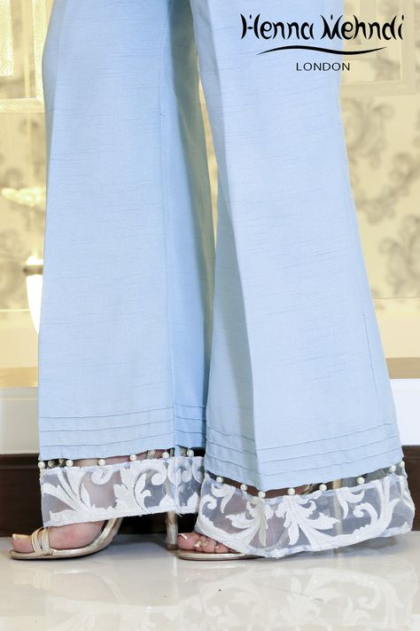 Designer Indian & Pakistani Ice Blue Embroidered & Embellished Trousers available in Salwar Trousers, Embroidered Trousers and Bootcut trousers. Designed in London UK. Free delivery over £75. Ice blue trousers with embroidery on borderline with pearl embellishment. Available in trousers, cigarette trousers or boot cut trousers. These trousers can be ordered in any colour. Please note delivery time is approximately 4-6 weeks. There is no exchange or refund̴on this product as ...