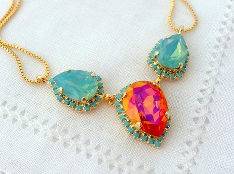 #weddings #jewelry #necklaces #bridesmaidgift #bridalnecklace #swarovskinecklace #pendantnecklace #rhinestonenecklace #weddingjewelry #statementnecklace #opalnecklace #crystalnecklace #orangeandblue #orangeblueopal #orangemintnecklace