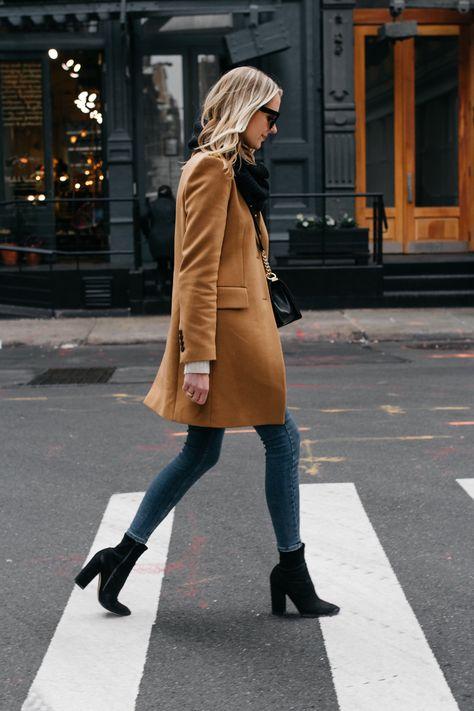 Blonde Woman Wearing Camel Coat Black Scarf Denim Skinny Jeans Black Booties Fas… – Famous Last Words