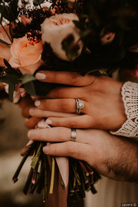 Gorgeous wedding day photography of couple - bride and groom holding bouquet with light pink roses to show rings {Layers}