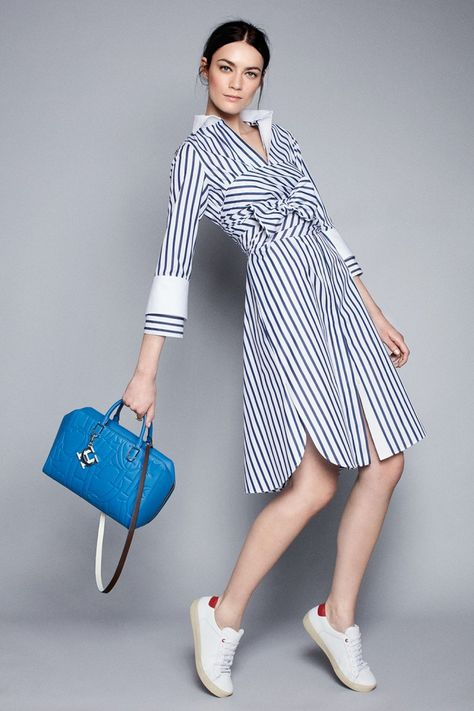 Long striped shirt dress with wite accenst on the sleeve. an ideal outfit for those cloud cast days. Matching white sneakers add a sporty touch to the uber casual look.