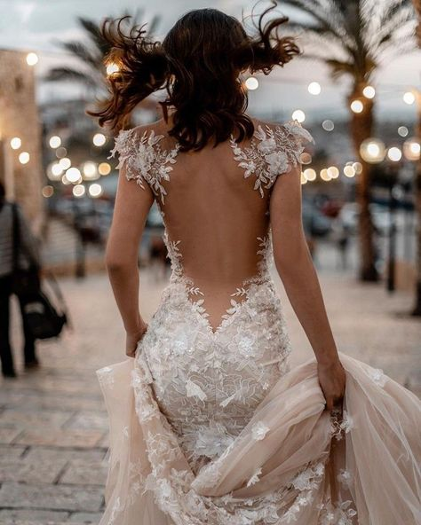 The magic and elegance of our stunning #Martha couture wedding dress with its sexy low back, sheer accents, and a dramatic embroidered blush tulle train with appliqués and scalloped lace trim.